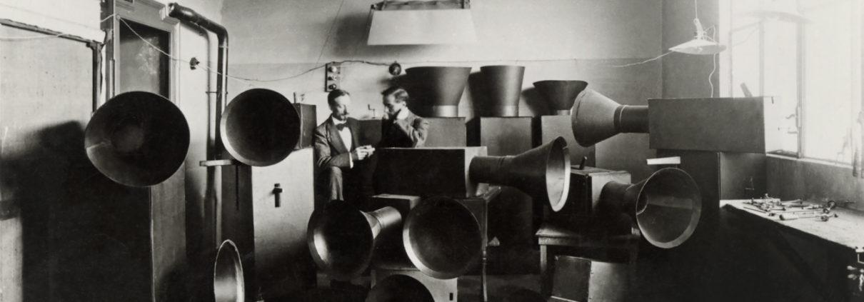 Luigi Russolo and his assistant Ugo Piatti in his studio with the intonarumori (noise machines)